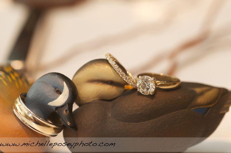 Ducks Unlimited wooden ducks with wedding rings Weddings
