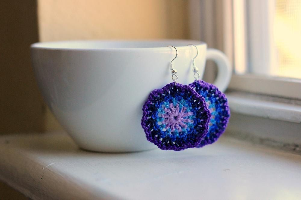 Handmade from round motifs crocheted in a cool purple and blue palette and accented with silver wire, these lacy earrings look stunning paired with black, white, or gray tops. Download the crochet pattern from LoveCrochet