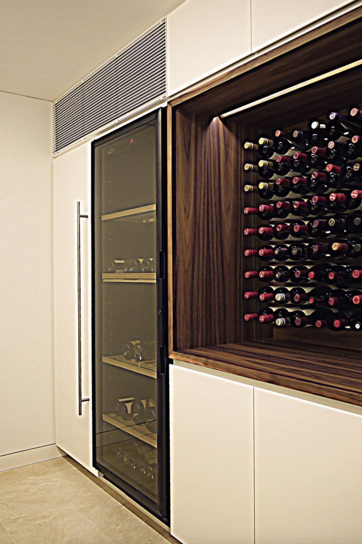 custom millwork wood wine cabinet in luxury kitchen ...