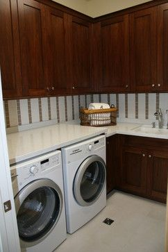 Nice laundry room in a small space with functional storage.