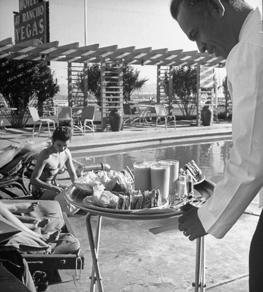 Vintage Las Vegas - Waiter serving guests by the pool at El Rancho Vegas Hotel & Casino (Photo by Jon Brenneis//Time Life Pictures/Getty Images)  Date created: 05 Feb 1947