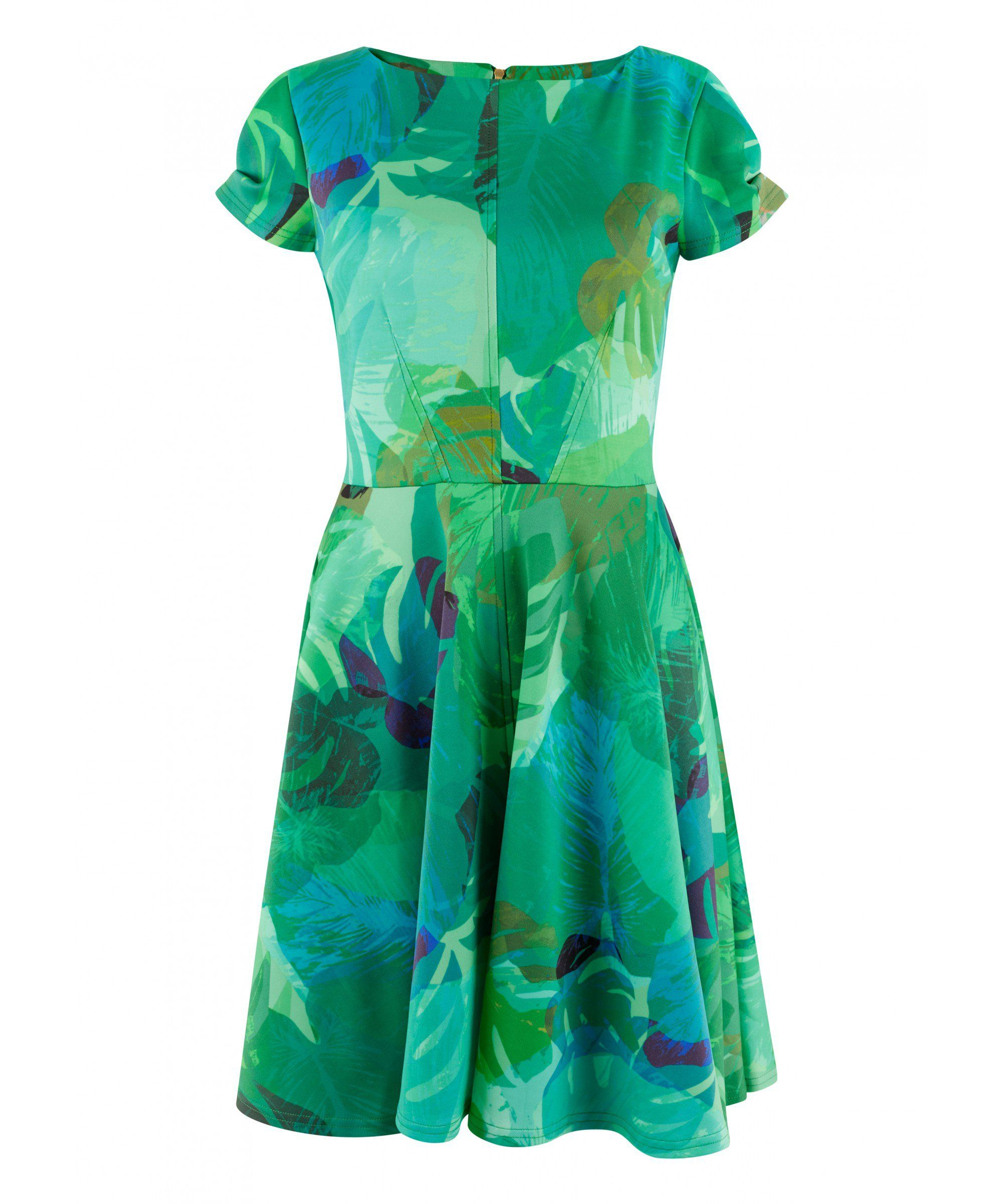 126d042d099 This skater dress has a beautiful emerald and jade green vibrant tropical  print. The pattern
