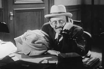 0 Clarence Wilson on the phone in  A Shriek in the Night  1933
