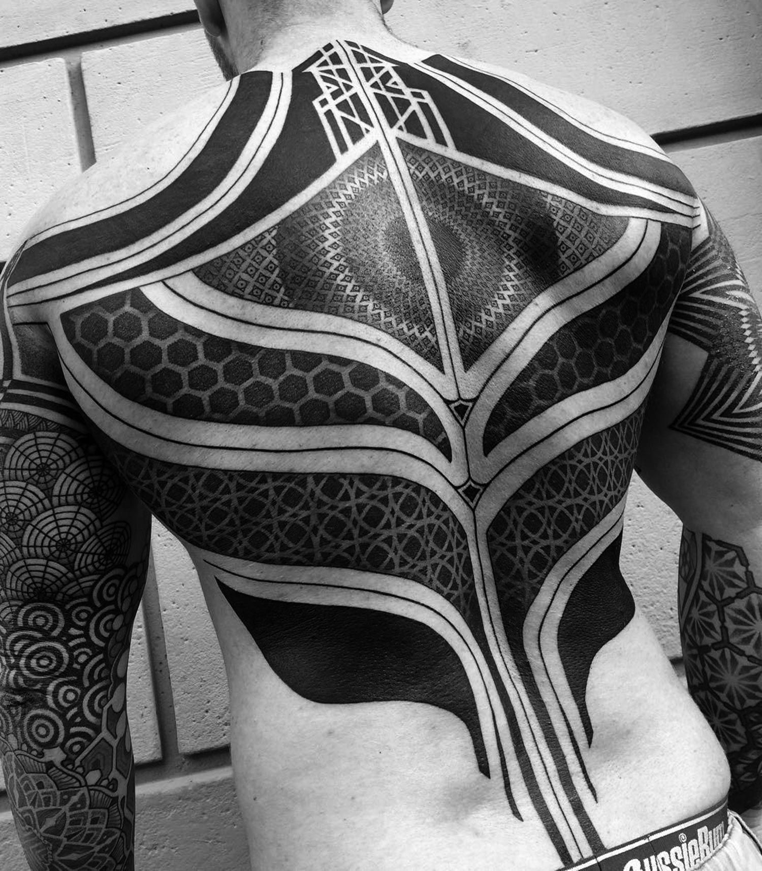 10 Artists Who Create Striking Geometric Tattoos Spanning The Body Electronic Circuit Board Full Sleeve Blackwork Male Tattoo A Big Bold Design Created By One Of Top Artist Nisssaco This Japanese Loves Dotwork Graceful Lines And Blacked Out Skin