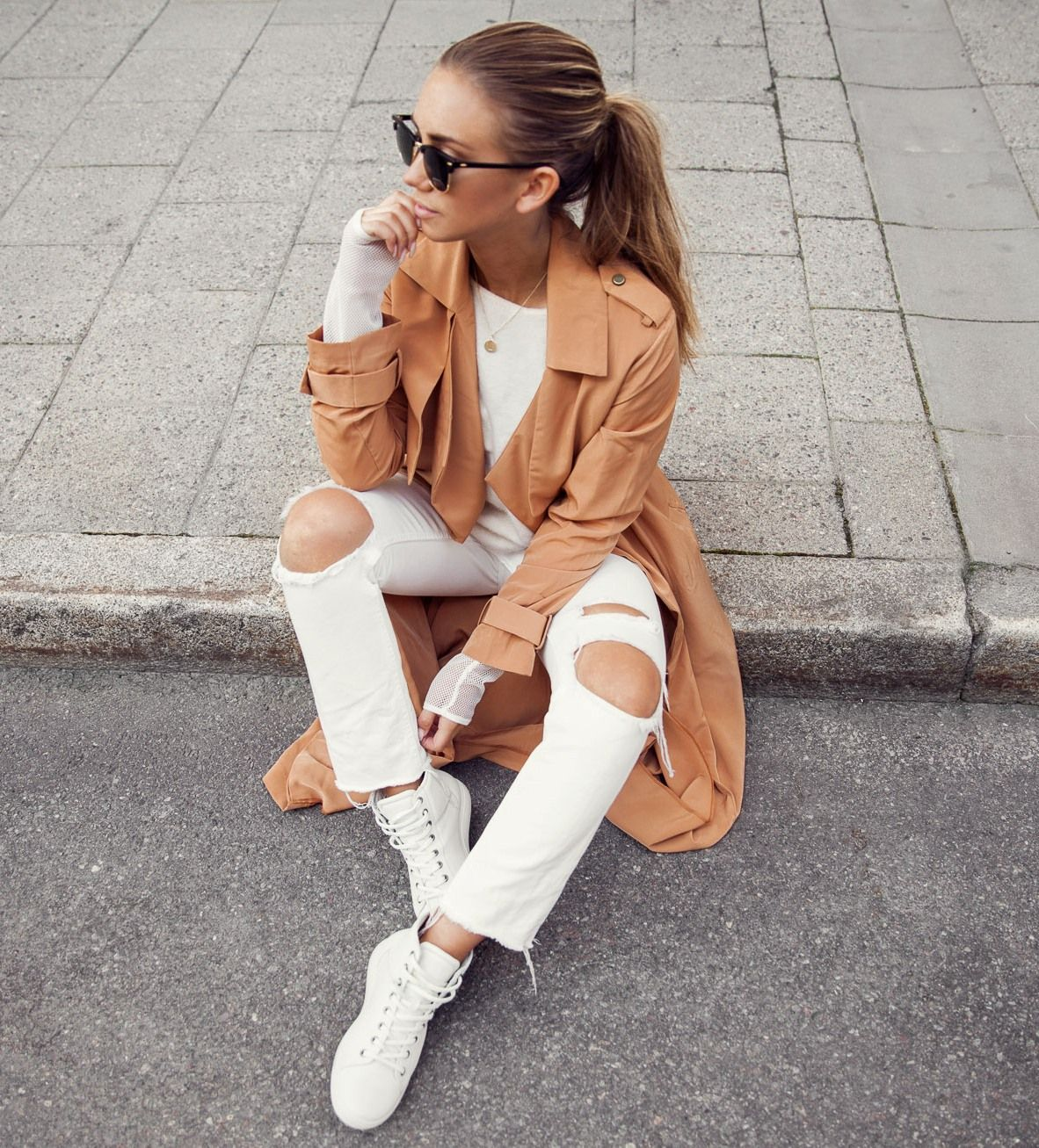 ripped white jeans and camel coat with wedge sneakers
