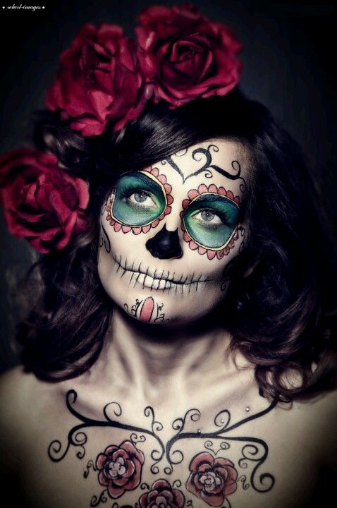 I pinned this sugar candy skull make up look as I like the overall design especially the simplicity of the mouth and the detail swirls on the forehead.