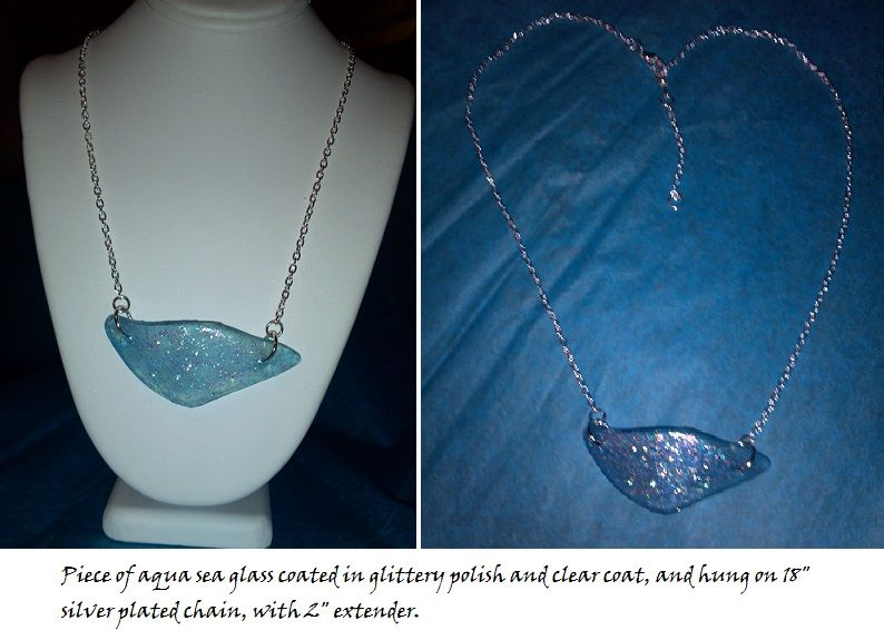 """Aqua sea glass, embellished with glittery polish and clear coat, hung on silver plated 18"""" delicate chain. Has 2"""" extender and lobster claw clasp. The aqua glass came from a Bombay Gin bottle."""
