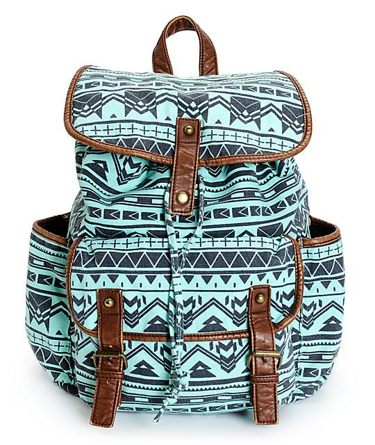 This small size rucksack backpack is designed with a tribal print canvas  exterior and contrasting faux leather trims 686990ecb4406