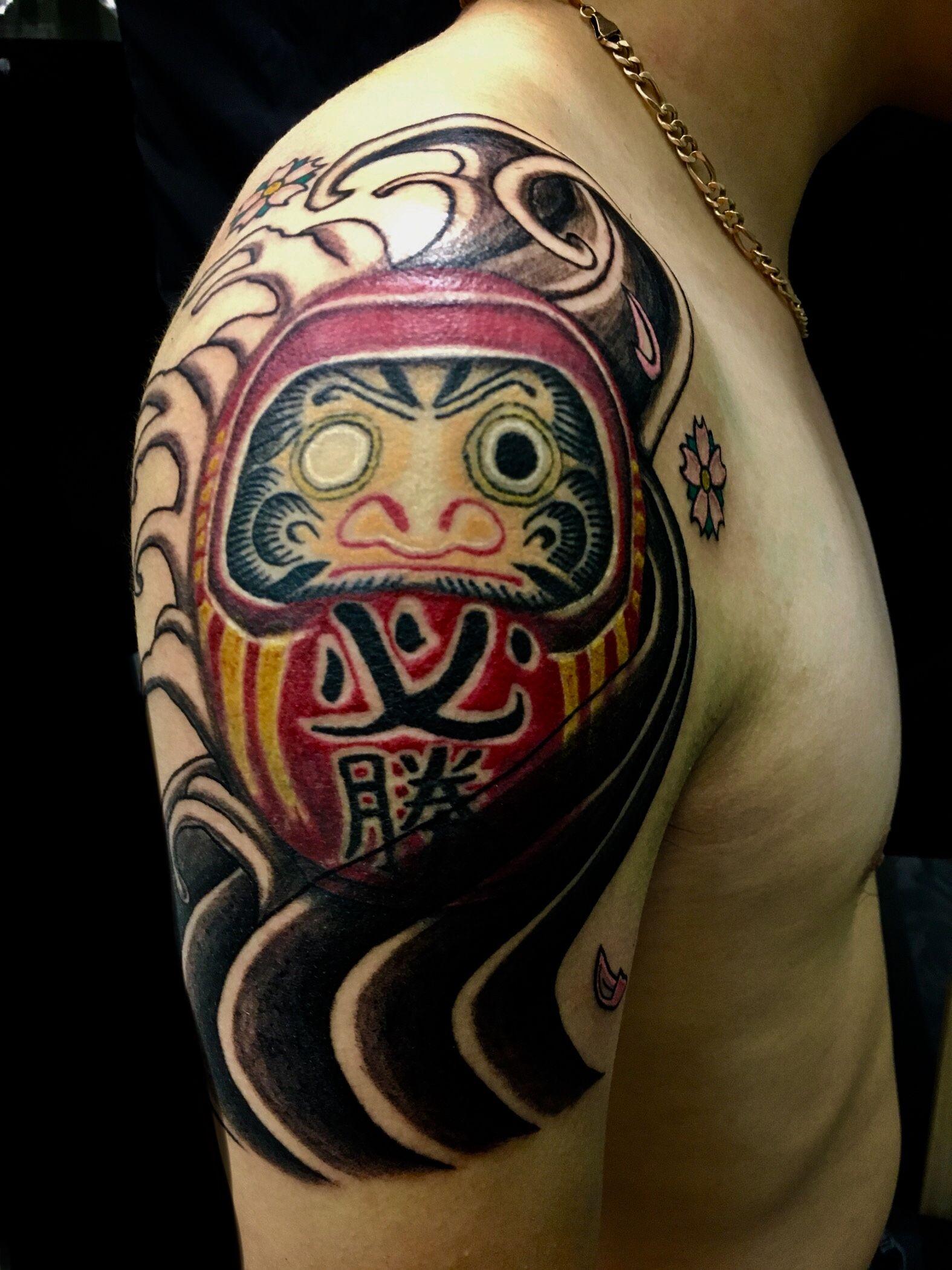 Daruma tattoo done by jon koon at artistic studio hair and
