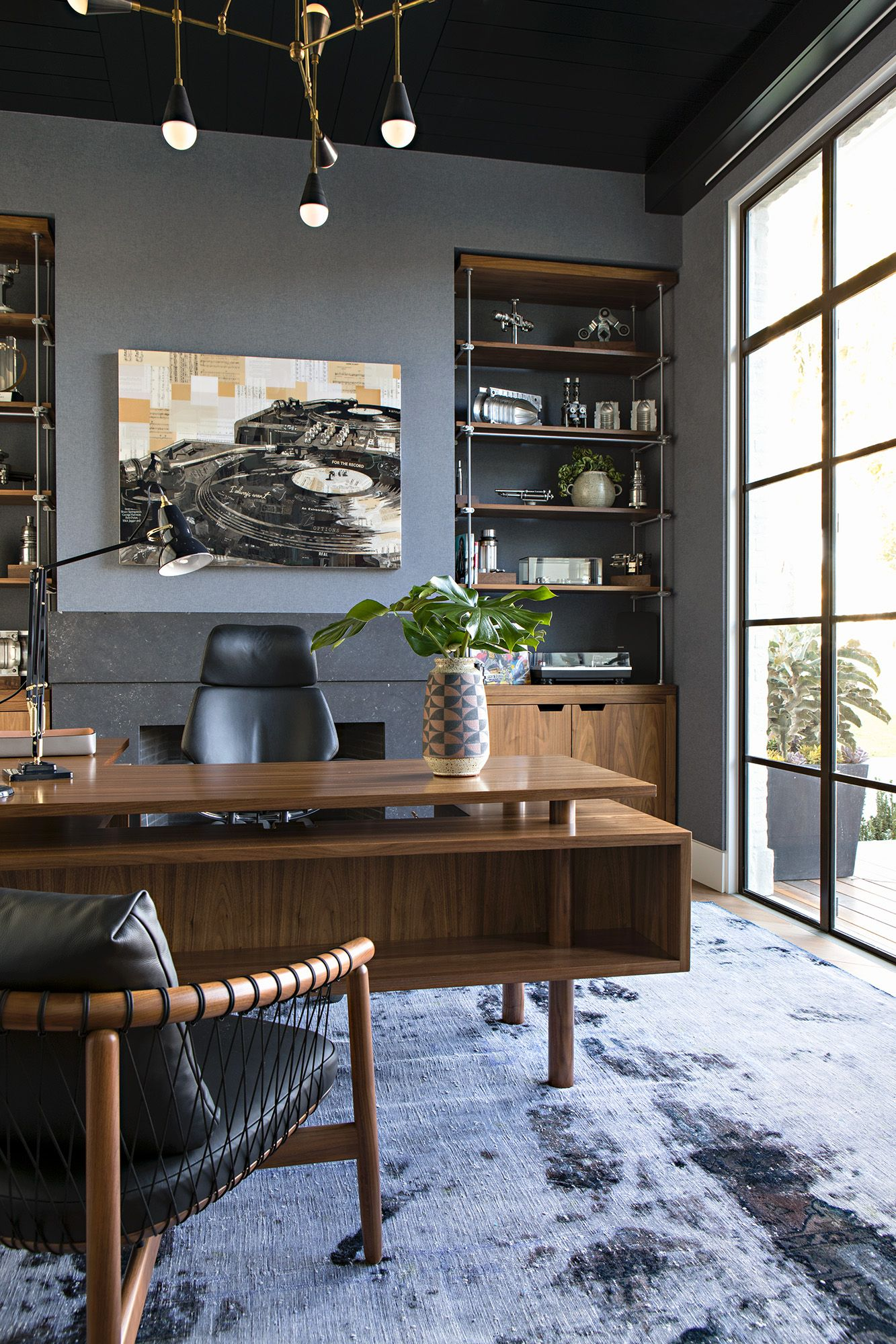 The owner\'s home office has custom brass and walnut built-ins that ...