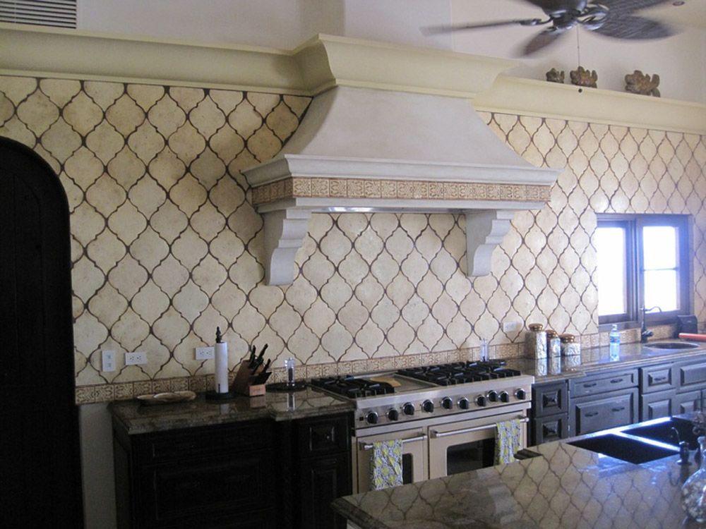Arabesque style cream colored backsplash tile with darker