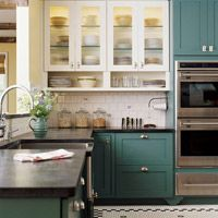 Glass cabinets, horizontal shelves, tile floor, concrete(?) countertops.