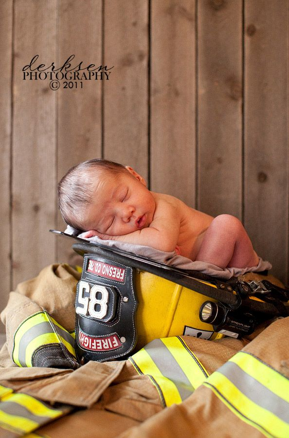 Baby in a firefighter hat another cute one if matt ever has babies awww just so cute wish i knew a fire man
