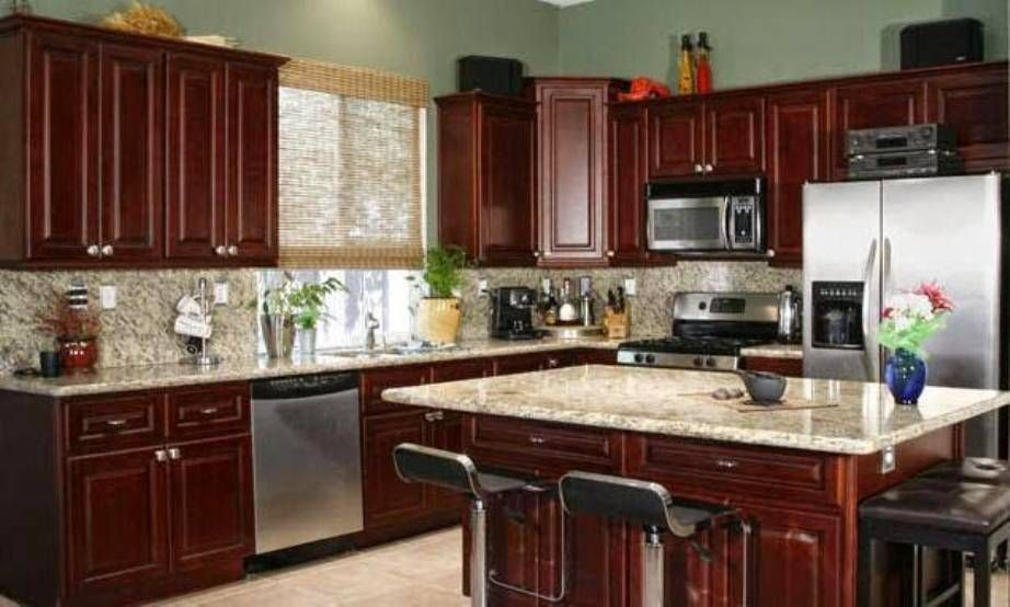 color theme idea for kitchen: dark cherry wood cabinets with a