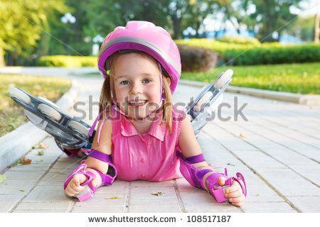 Cheerful Preschool Girl Wearing Inline Roller Skates And ...