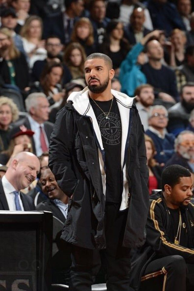 52110fb63b1e Drake - At the game between the Toronto Raptors and the Brooklyn ...