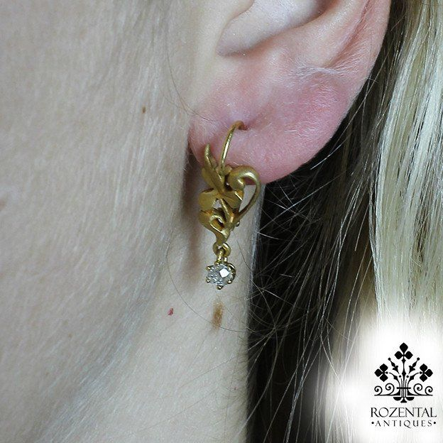 Period: Art Nouveau (1890-1919) Composition: 18K Gold Stones: 2 Old mine cut diamonds of I-SI1 quality that weighs 0.40ctw Earring measures: 27mm by 9mm Thick: