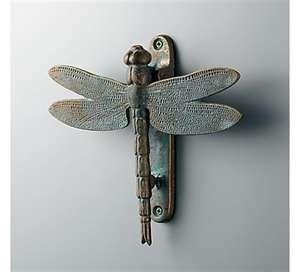 Brass doorknocker with green patina.