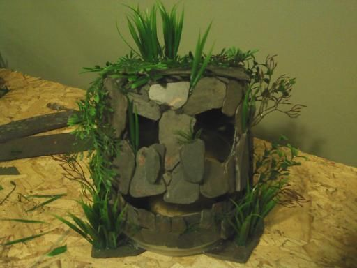 Monster fish cave made from slate tiles fish aquariums for Homemade fish tank decoration ideas
