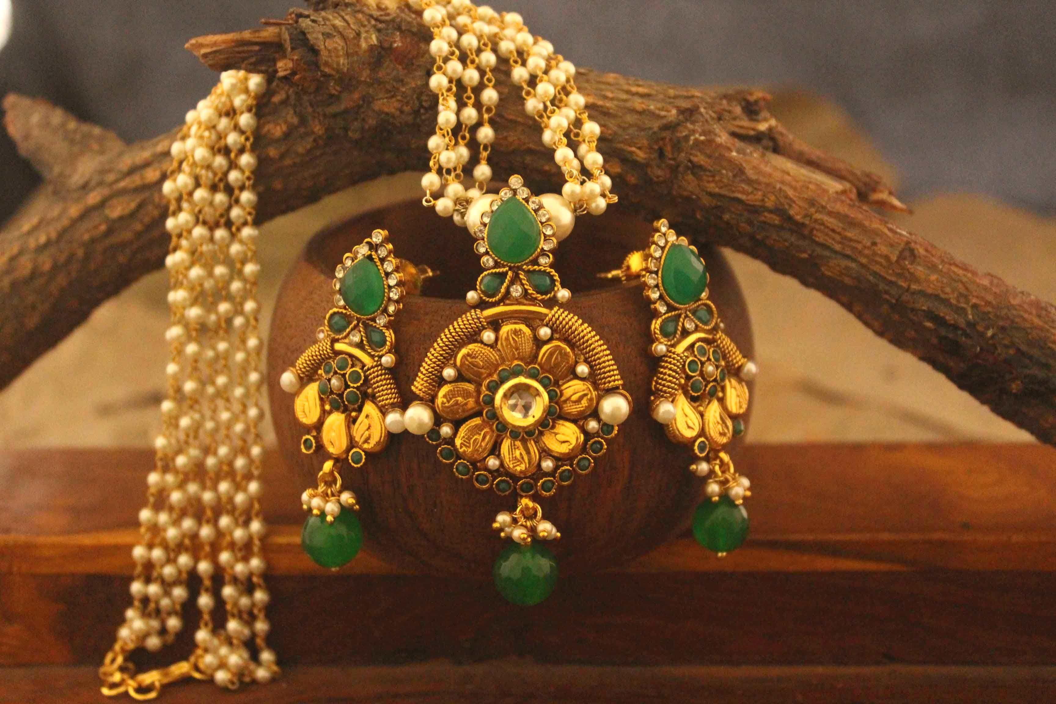 This is antique golden designer set with pearl work it is pure