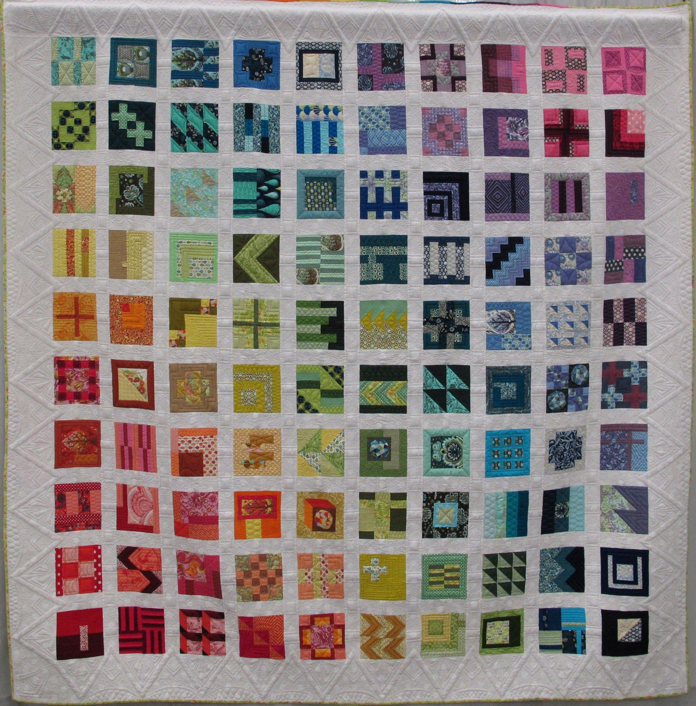 Modern sampler quilt in a rainbow of colors: