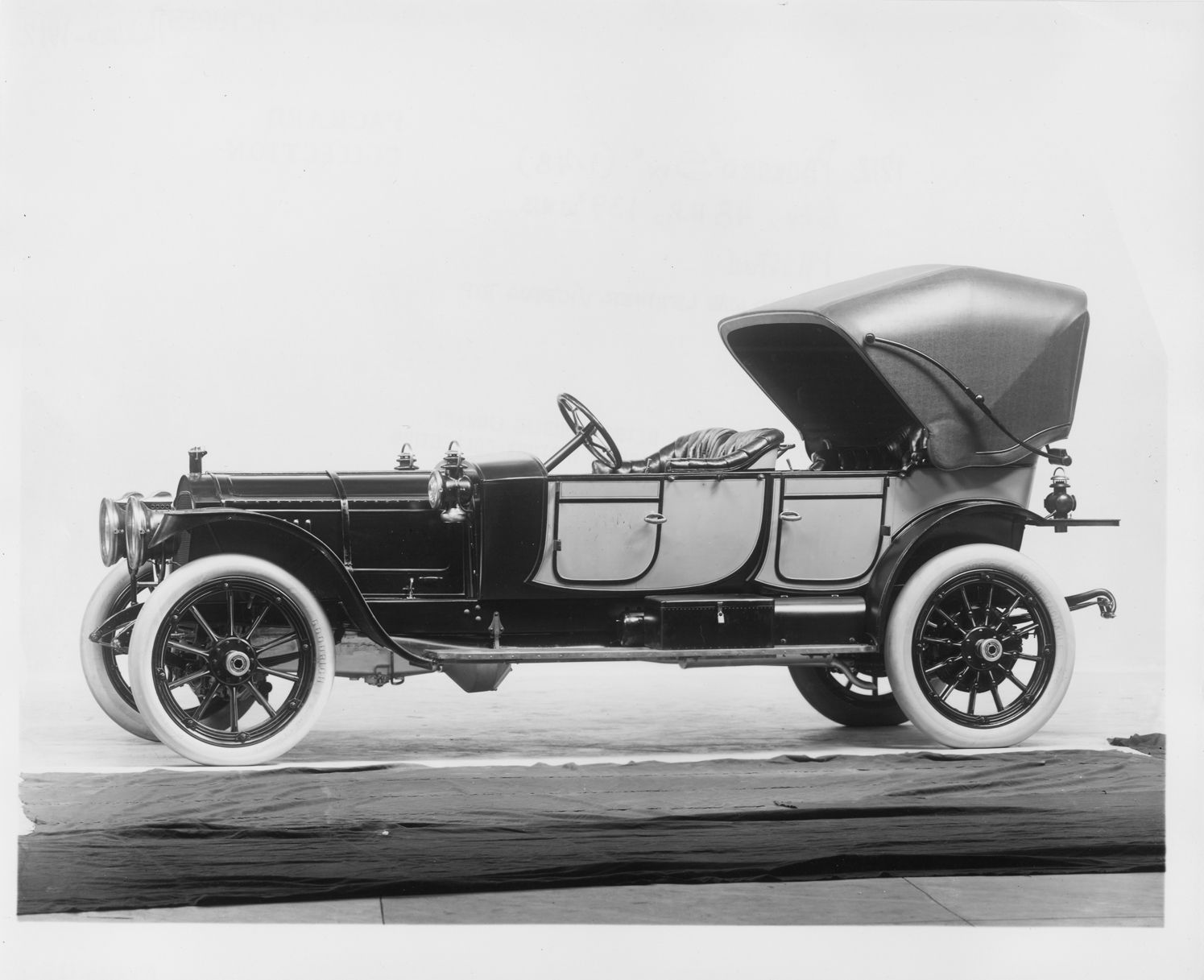 1912 Packard 6 two-toned phaeton, 6-cylinder, 48-horsepower, 139-inch wheelbase, fitted with leather victoria top.