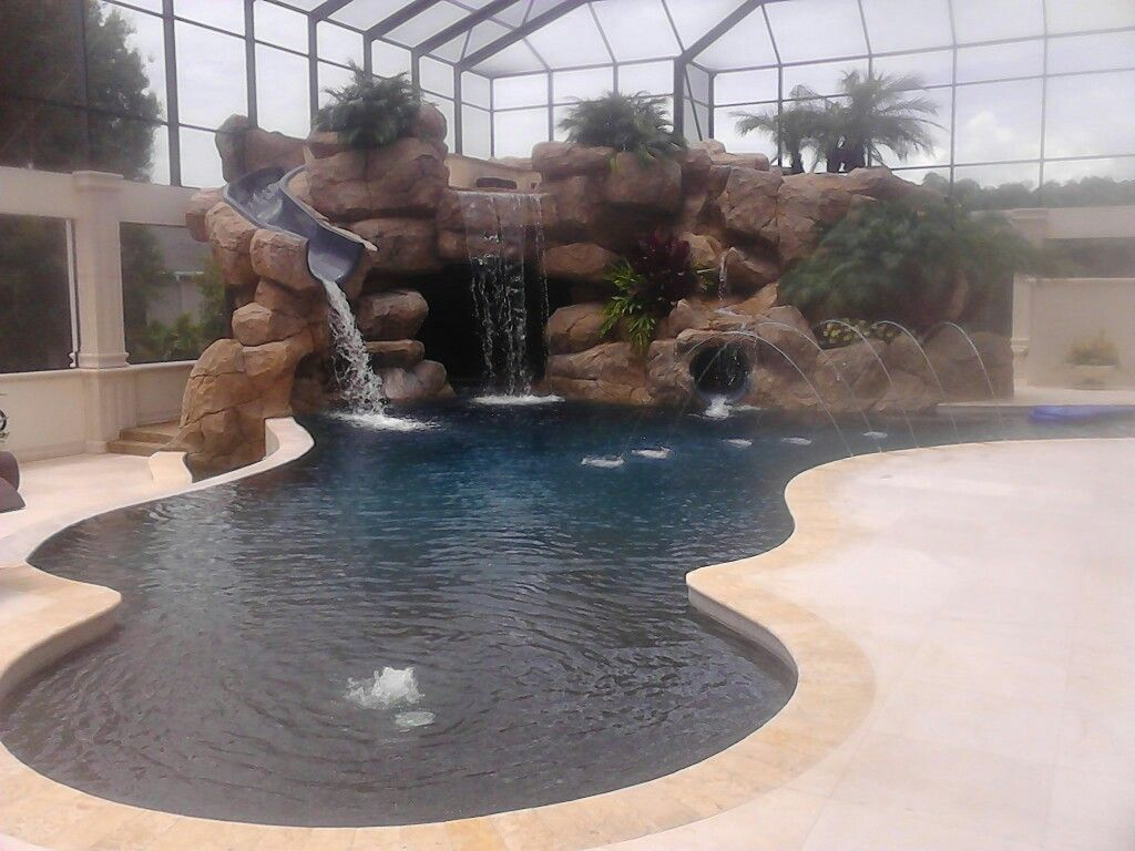 This is a pool I built for John Cena . 2 waterslides 3