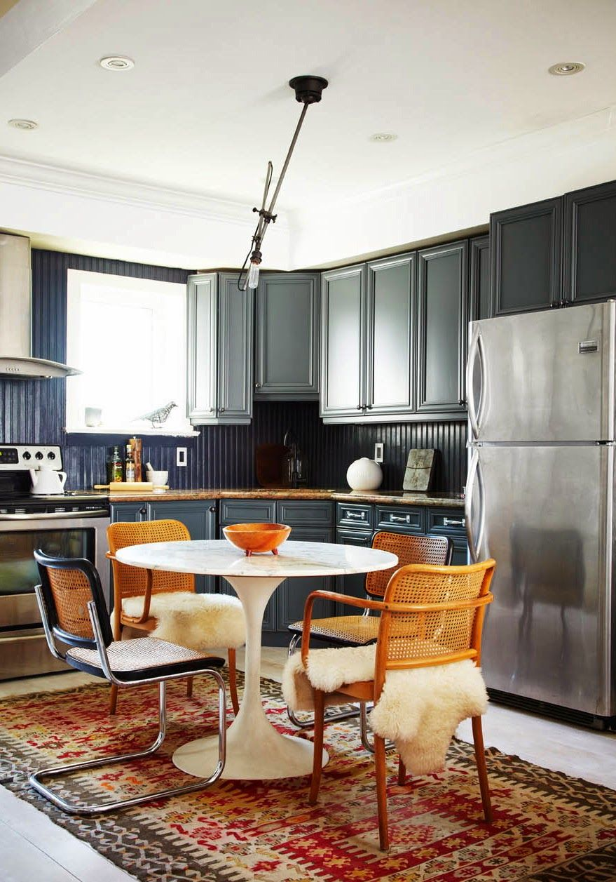 Breuer chair cane - Eat In Kitchen With Navy Cabinets Kilim Rug White Tulip Table And Cane Back Chairs