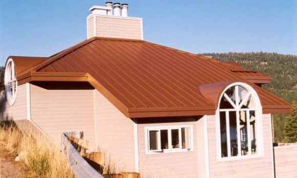 A Copper Roof On Small House In California