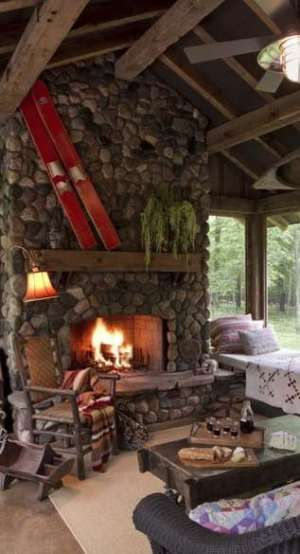 Cabin fever hot fireplace designs home sweet home for Log cabin fireplace designs