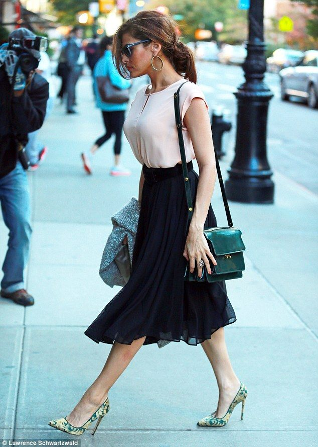 Clever dressing: Eva Mendez knows what suits her figure and consistently gets it right by teaming flowing skirts with a cinched-in waist and heels