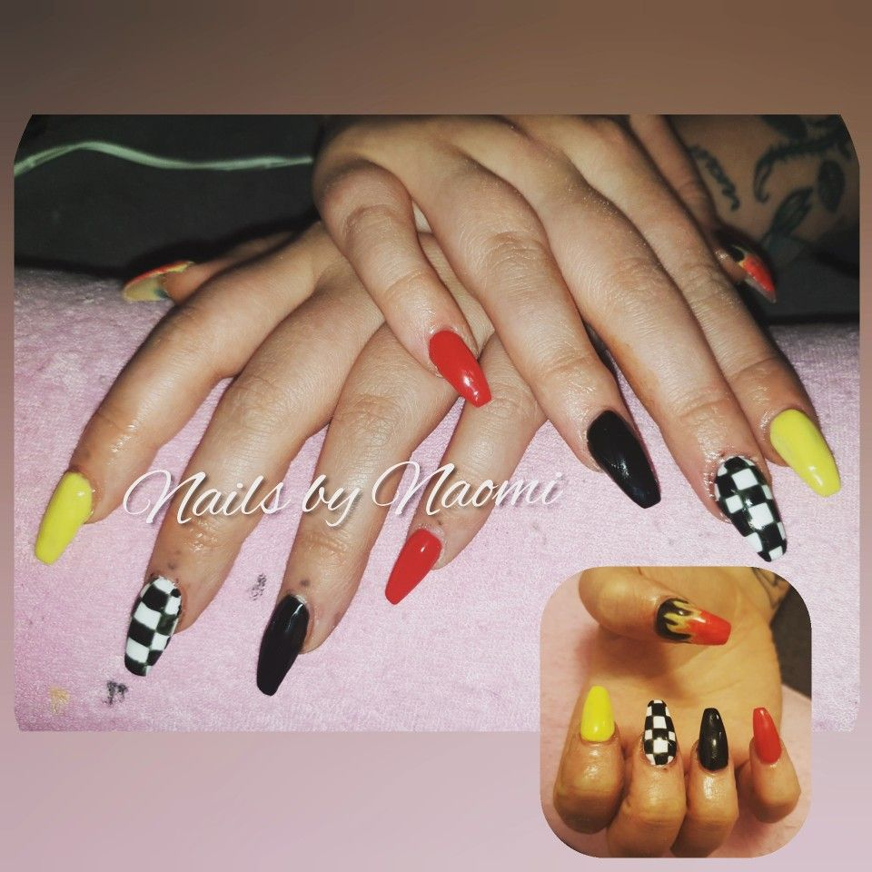Full set acrylic nail extensions, with red, yellow, black
