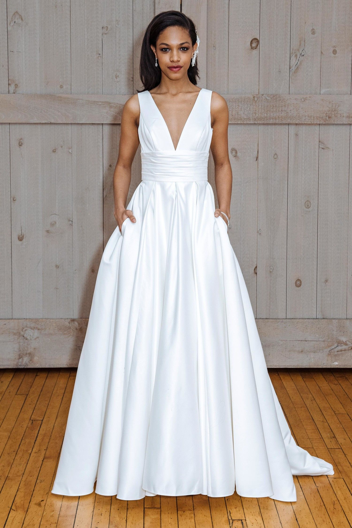 bf7fbe26f366f A-line wedding dress with V-neckline, wide straps, and pleated skirt