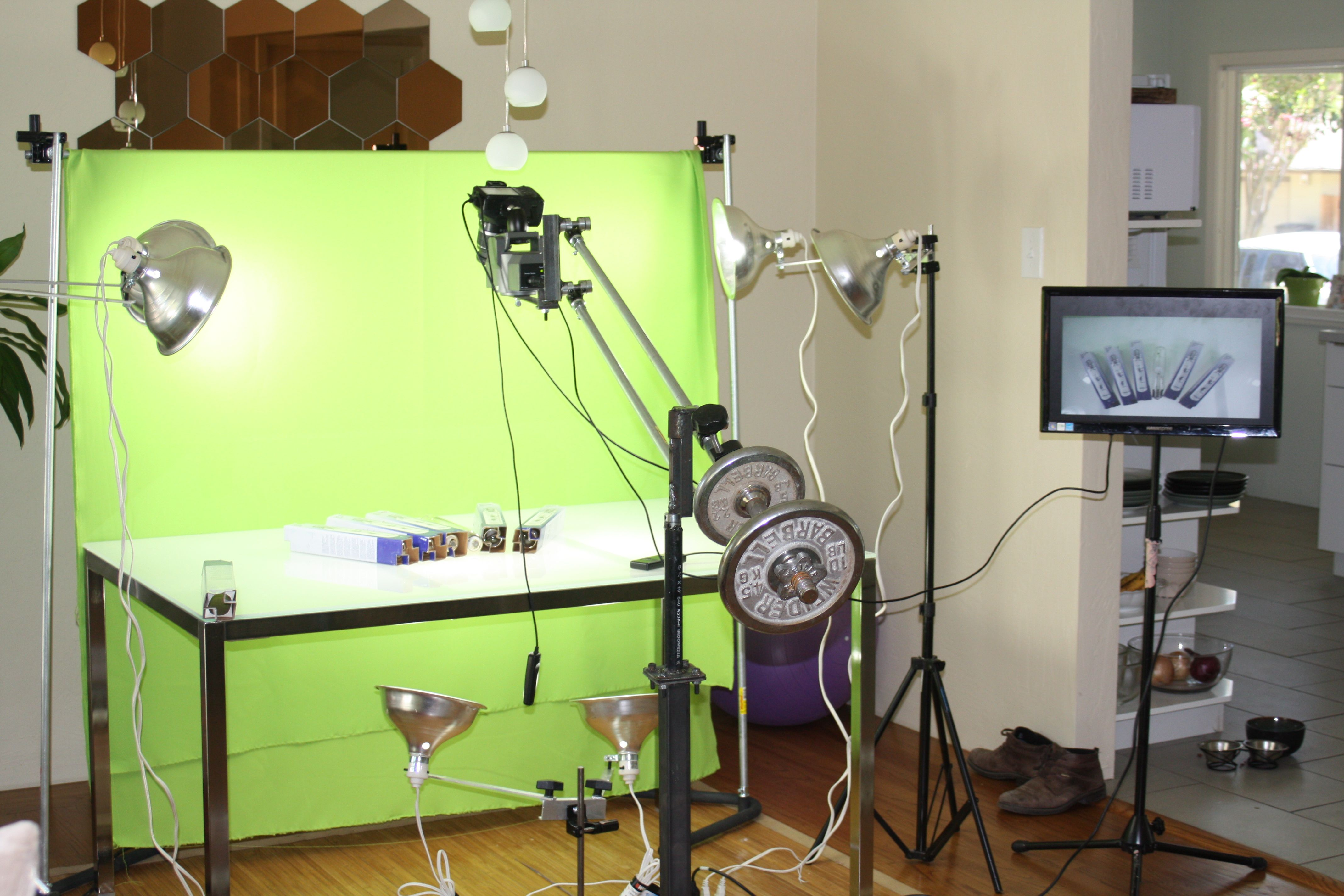 Set up for photographing products. Green screen is used
