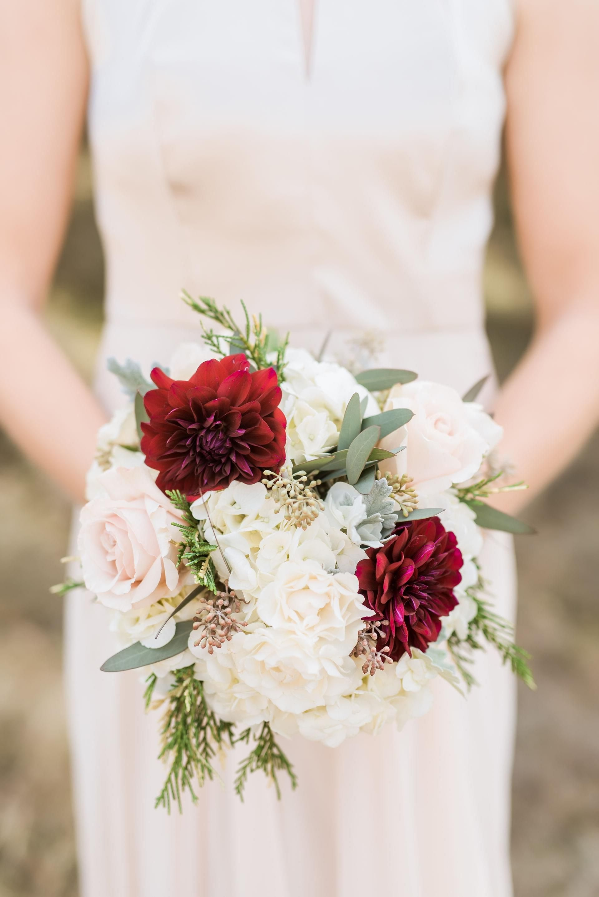 Wedding bouquets red and white roses  Natural Austin Glamour  Dripping Springs TX  Stock flower