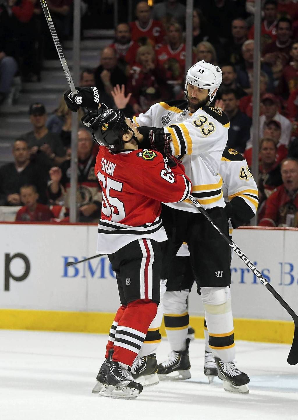 d66537028 Andrew Shaw takes a shove from the much larger Bruins defenseman Zdeno  Chara in the first period...Sure Claude