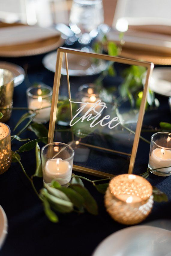 Photo of Items similar to hand lettered table numbers | Hand lettered gold framed table numbers | Acrylic table numbers | Custom wedding signage | Modern calligraphy on Etsy