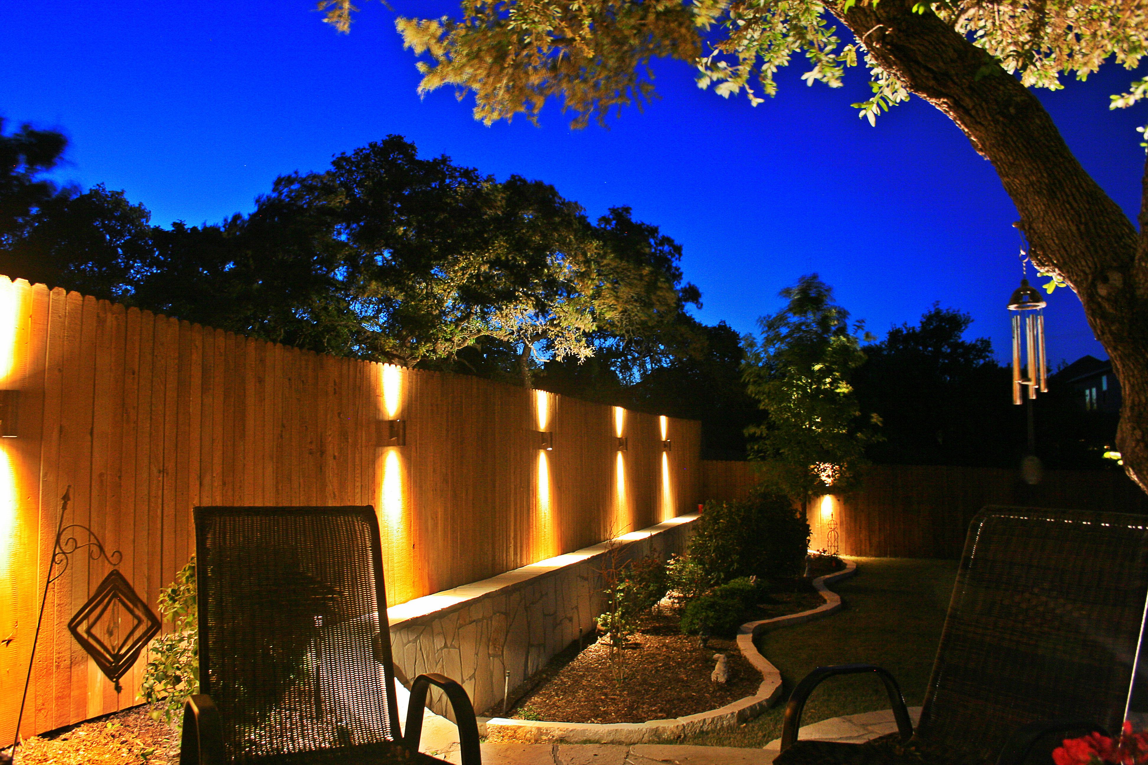 Up / Down Sconce Lighting on the Fence created dramatic