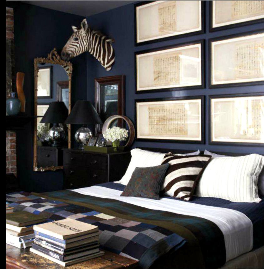 Traditional Bedroom Ideas For Men the wide frames holding multi-shaped/sized prints over bed. blue