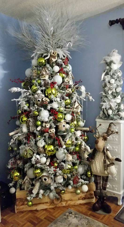 Christmas Tree Rustic Theme. Flocked Tree decorated with bird ...