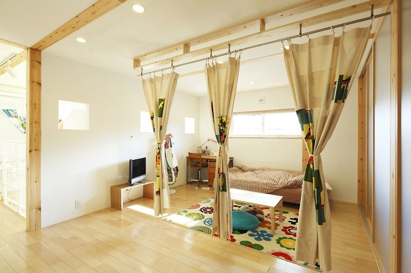 I like the idea of having curtains to separate the bed space from
