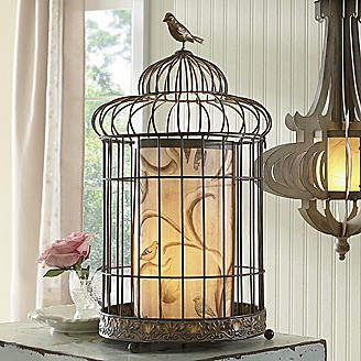 this might be easy to make - buy a paper lamp & find an old birdcage...