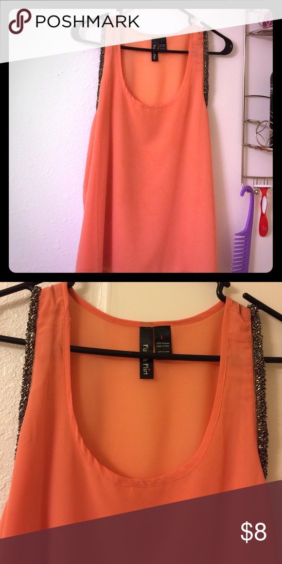 Pink tank with silver lining Size large pink blouse. Silver lining. Worn a few times. Coral. Tops Blouses