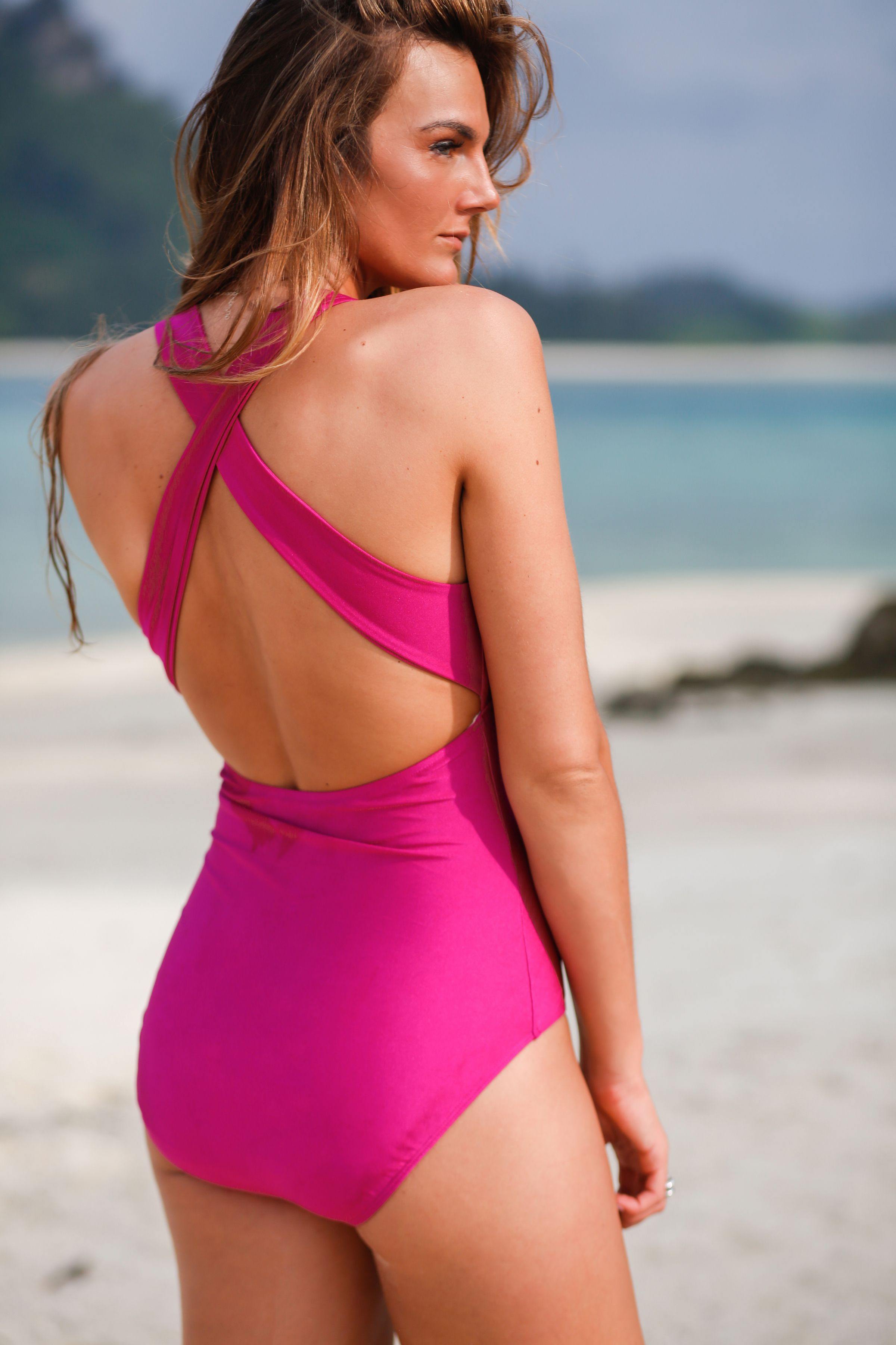 5bfa288dc7fe0 Final sale · Say hello to the Magenta Shell Shock V Neck Swimsuit! This one  piece provides comfort