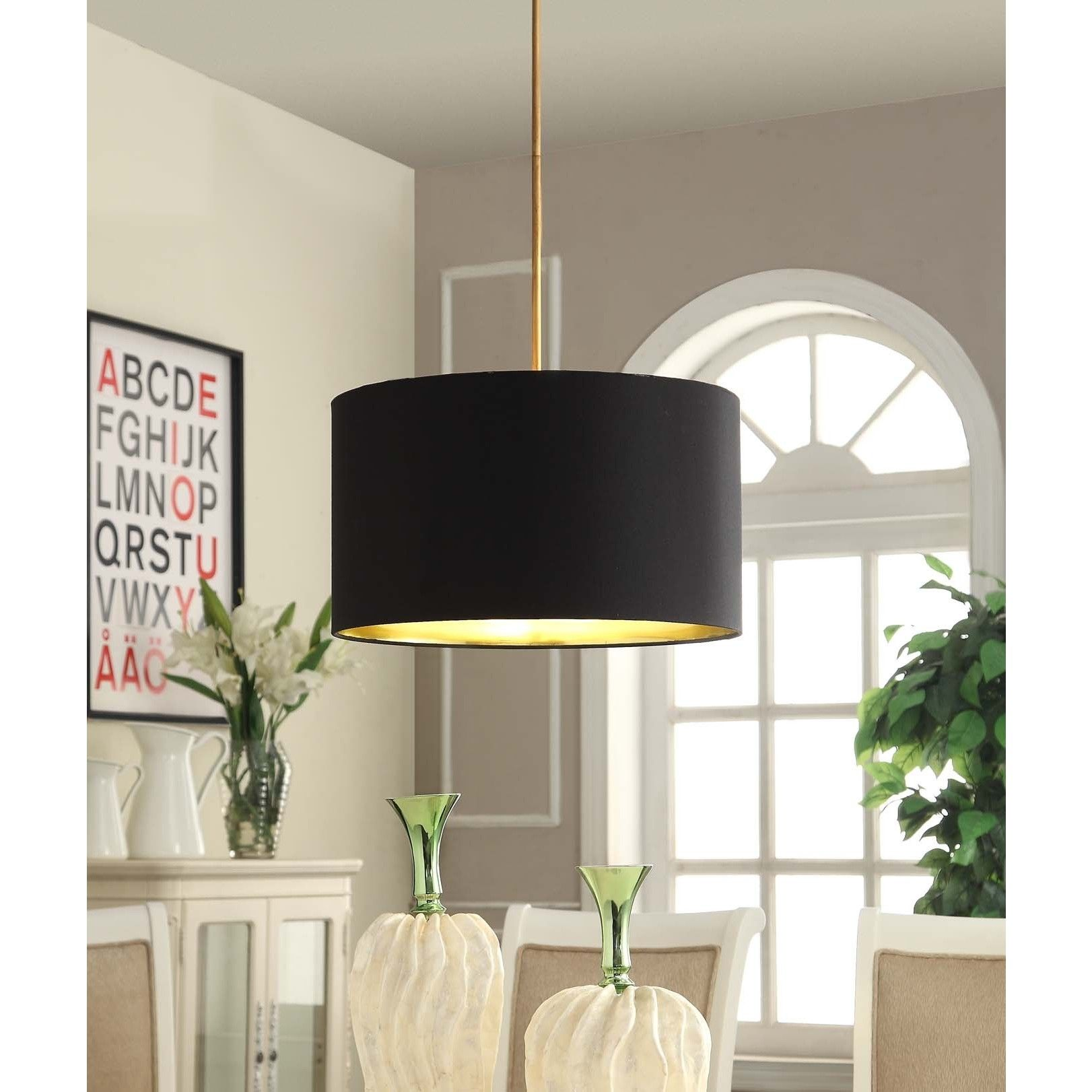 This lovely pendant features a black linen shade that is