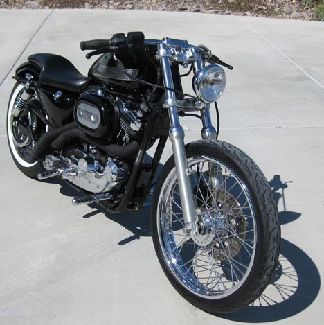 Photo of 1998 Sportster Bobber with 1200cc Harley Evo Engine and black wrapped exhaust pipes.