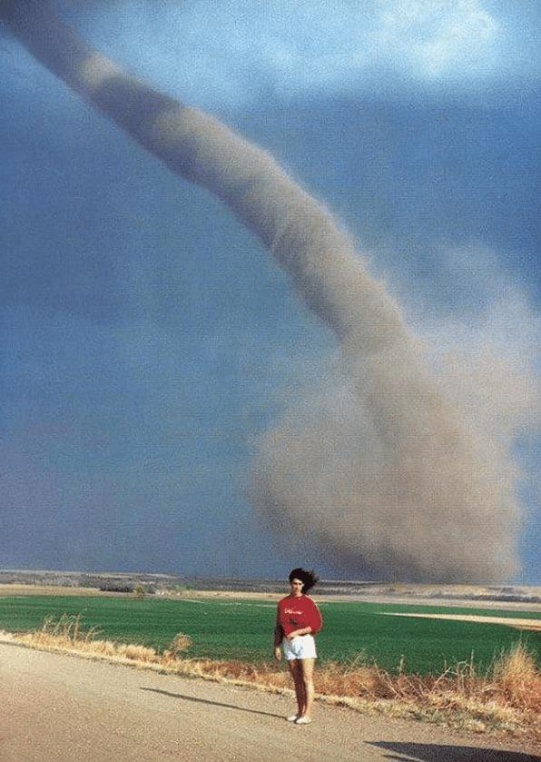 Nebraska woman with a tornado in the background, 1989 in