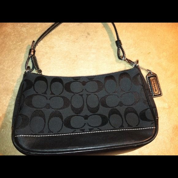 😍REDUCED😍Authentic black Coach purse Black canvas and black leather. Gently worn. In great condition, this purse measures approximately 7.5 inches by 5 inches. Serial no. AIJ 6094. 100% authentic! Coach Bags