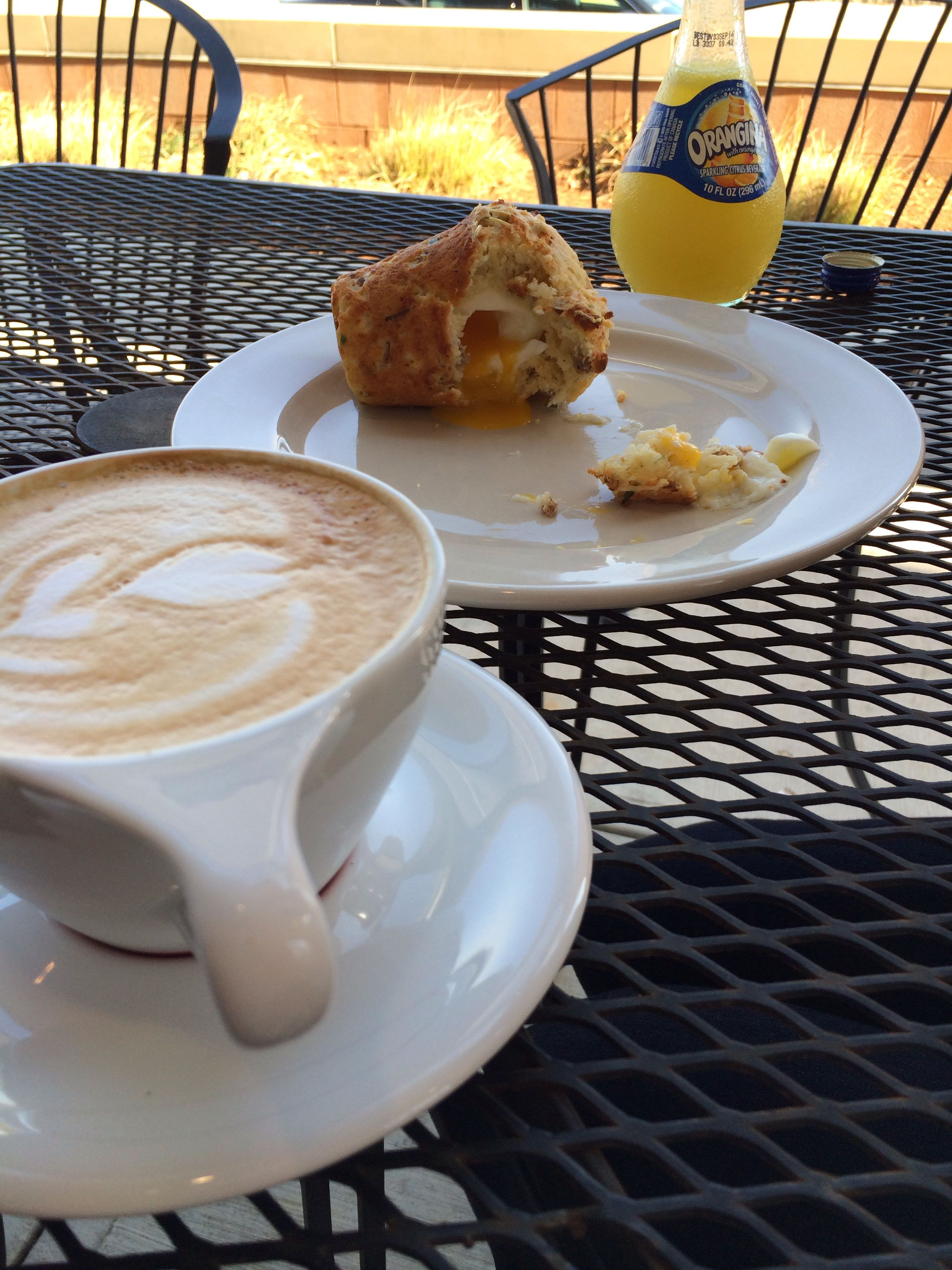 Breakfast at Comet Coffee, with their famous Rebel Muffin with a soft boiled egg inside. I'm having a flat white and Brit's enjoying an Orangina.