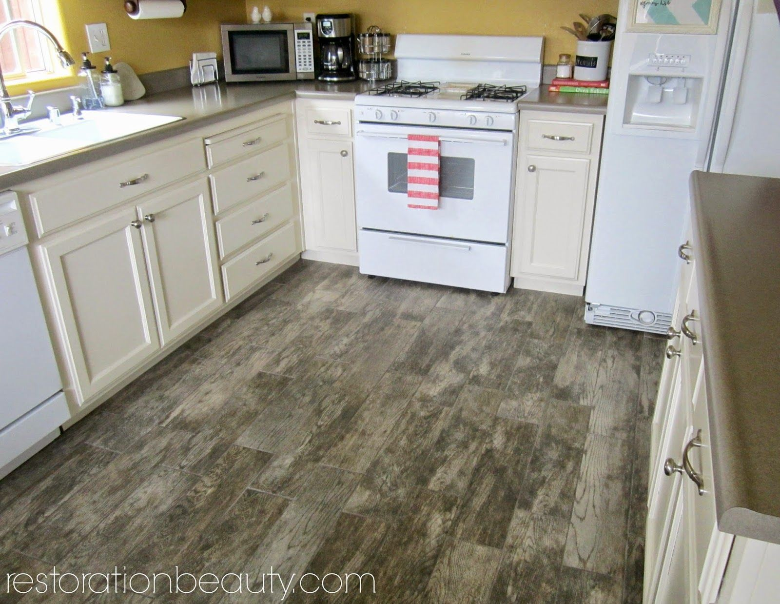 Faux wood tile flooring in the kitchen faux wood tiles wood tile faux wood tile flooring in the kitchen dailygadgetfo Gallery